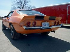 The distinctive round tail lights of the 70-73 Camaro. No other Camaros, even other 2nd gens, came with round tail lights, making this a very unique feature.