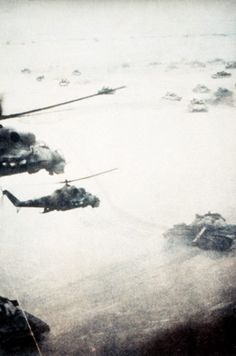 Soviet tanks and  MI-24 Hind's in movement while conducting an operation against jihadis, during Soviet War in Afghanistan.