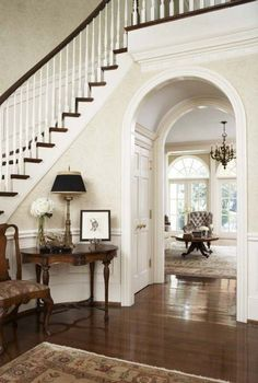 Love the darker wood floors and high ceilings.