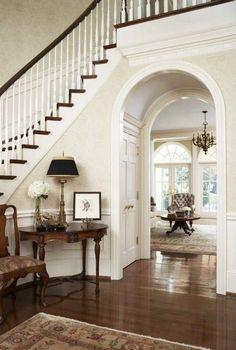 Door under the arched walk through utilizes space under stairs. Good idea.