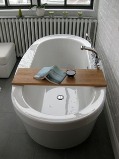 wood bath tub tray. so simple. so awesome.