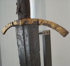 """This sword could arguably be a Type XVI or a XIV. Due to it's length and diamond cross section above the fuller I have opted to include it in Oakeshott's Type XVI.  Reign of Jean II of France (1350-1364), reign of Philippe VI (1328-1350) Lettering in gilt brass in the central fuller: """"Nulla de virtutibus tuis major clementia est"""" (""""None of your virtues are greater than clemency""""). Overall length: 97 cm (38.2"""")…"""