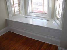 bay window bench idea--make it hollow with a lift-up bench seat for hidden storage?