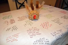 I love this tablecloth!  Every year everyone at Thanksgiving writes on the tablecloth what they are thankful for.  Then I stitch over their handwriting.  We have a keepsake of family members' words and handwriting!  Perfect:)
