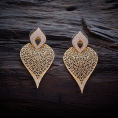 Fashionable Design CZ Zircon Stud earrings studded with synthetic stones, and gold Polish.