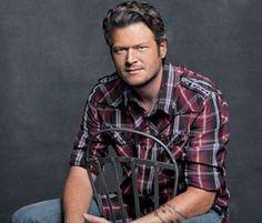 Blake Shelton. My kids' friends think he looks like my husband!  :O)