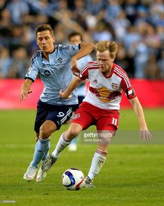 krisztian-nemeth-of-sporting-kc-and-dax-mccarty-of-new-york-red-bulls-picture-id465634380 (813×1024)