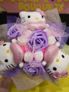 Hello Kitty plush doll flower bouquet. Pink, red & purple theme