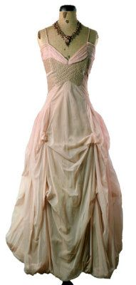 Prima Ballerina Dress    There are no words to adequately convey the beauty of this gown. Seemingly vintage, dusty rose chiffon is ruched along the bosom, while tea-hued embroidery graces the fitted bodice, cinched by a wide, gathered back sash inserted further back than the side seam. A blouson hem poufs at ankle. An ethereal shrug is edged with scallops and gathered with dainty grosgrain ribbon offering arm insertion. Spaghetti straps and back zip.