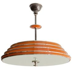 Swedish art deco Bohlmarks stepped chandelier chrome and lacquer    height: 25 in. (63 cm)  diameter: 25 in. (63 cm)  539 E 12th Street  New York, NY, 10009  Phone: 212-505-5344
