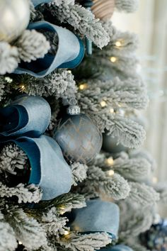 New Chritmas 2018 Trend? Peacock blue and dark blue layered ribbon on pre lit flocked white Christmas tree. Blue Christmas Tree Decorations, Silver Christmas Tree, Merry Christmas, Christmas Colors, Christmas Themes, White Christmas, Christmas Holidays, Christmas Ornaments, Peacock Christmas Tree
