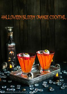 Halloween Bloody Orange Cocktail - Mommyhood's Diary. Halloween never tasted better…This cocktail is so easy to make and yours guests will freak out over the flavor!  #SpookySnacks #shop