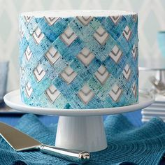A fondant chevron design with the look of faded denim gives this cake a comfortable attitude in any setting. The decorating is easy thanks to the Burlap Pattern Embosser and roll on coats of Color Mist Food Color Spray.