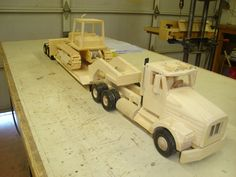 Peterbuilt Semi truck with lo-boy trailer carry a Dozer