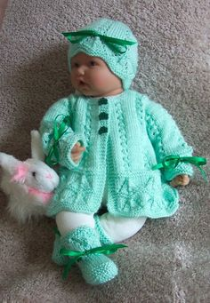 Handmade Green baby or Reborn Sweater hat booties Layette Easter St Patricks Christmas Gift with Shamrock buttons - 0 Ready To Ship Handmade knitted by Grandma Anne. Lovely for St Patrick's day or of Creative Dolls Designs Knitting Pattern M Baby Knitting Patterns, Baby Patterns, Hand Knitting, Vintage Knitting, Sweater Hat, Baby Cardigan, Baby Sweaters, Girls Sweaters, Knitted Dolls