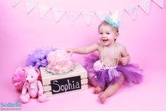 Baby girl cake smash photo shoot. First Birthday.