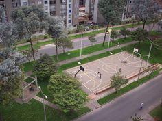 Basketball court built into a road median in Bogota