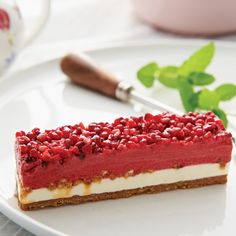 RASPBERRY SORBET SLICES   This layered dessert is a textural and flavourful experience, expertly crafted so each layer impacts and delights. The crunchy base is made of white chocolate and almond praline. It is then topped with a layer of intense vanilla bean parfait (similar to ice cream) and ingeniously crafted caramel nougatine which cuts through the bright and flavoursome raspberry sorbet. It is a succession of flavours on your pallet that provides pleasure with every mouthful. Italian Cherries, Pizza One, Pesto Pizza, Raspberry Sorbet, Layered Desserts, Wood Fired Oven, Cherry Tomatoes, White Chocolate, Parfait