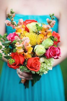 bright spring bouquet, photo by Haley George Photography http://ruffledblog.com/handmade-south-carolina-wedding #flowers #bouquet #wedding