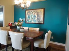 Teal accent wall for dining room (window wall) possibly deep red curtains to bring the red/teal color scheme together.