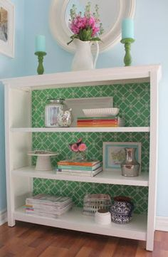 I like the idea of patterns (or bold colors) as the back of shelves or bookcases