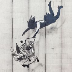 """Shop Until You Drop in Mayfair, London. Banksy has said """"We can't do anything to change the world until capitalism crumbles. In the meantime we should all go shopping to console ourselves"""