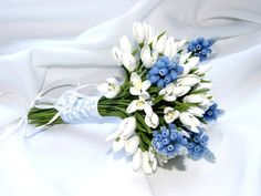 handmade bridal bouquet of polymer clay, white snowdrops and blue muscari