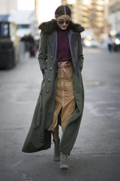 There's a reason Olivia is considered the queen of street style. During NYFW, Olivia stepped out in a trendy suede skirt, which she paired with a maroon turtleneck and floor-skimming military coat.