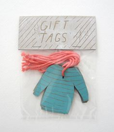 The cutest teal sweater gift tags with coral thread