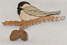"Chickadee. 19 pieces. Approx. size 8""x5"". Made of Ebony, Blue Pine, Maple, Cherry & Black Walnut."
