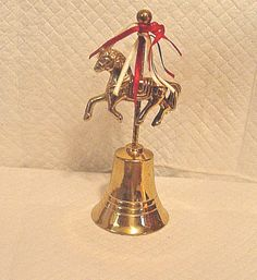 BRASS BELL WITH A CAROUSEL HORSE ON THE HANDLE/POLE 5 7/8 TALL