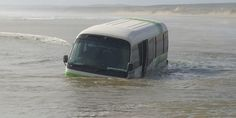 Tourists on a bus at 90 Mile Beach got more than they bargained for yesterday when the bus they were traveling in was washed out to sea. - New Zealand Herald...
