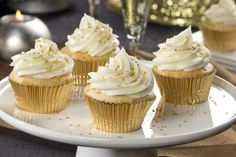 A hint of bubbly in the batter and the frosting makes these Champagne Cupcakes truly New Year's Eve-worthy! These sparkly cupcakes are fun, festive, and perfect for any special occasion. Gold Cupcakes, Wedding Cupcakes, 60th Birthday Cupcakes, Sweet 16 Cupcakes, Glitter Cupcakes, Champagne Birthday, Champagne Party, Champagne Glasses, Cake Cookies