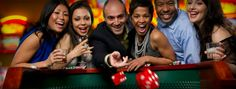 excited-friends-gambling-at-craps-table-in-casino.png (600×228)