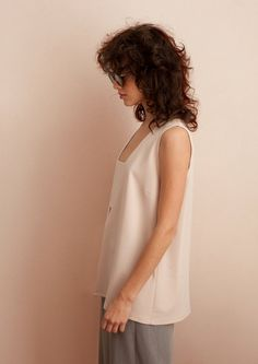 Deep v neck tank top with suttle cut out detail. Sleeveless loose summer blouse, great for evening and elegant look, or casually pair with jeans for everyday look. - Available in pinkish nude or black polyester lycra blend. - Ready to ship - Ships worldwide from Tel Aviv, Israel - Available in sizes S-L - See size chart in photos - Hand wash in cold water  ================= Feel free to contact me with any question - I would love to hear from you