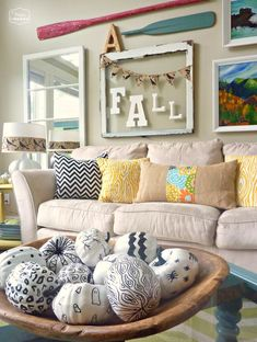 Love the couch & pillows. And the Fall sign, & the black & white pumpkins!!!