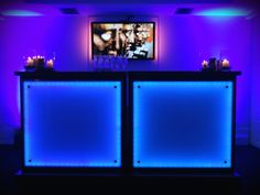 An LED blue bar creates a bold and elegant drinks reception for an event in the Gallery
