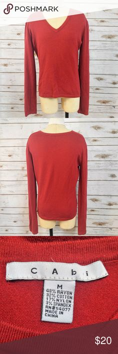 CAbi Red V-Neck Sweater CAbi Red V-Neck Sweater Size medium in good used condition with minor pilling. Please feel free to ask any questions or bundle with other listings in my closet for a custom discount on your order. I ship the same day as long as the order is placed before 11:00 AM Central time. If you would like to be notified about price drops remember to 'like' the item to bookmark it! Thank you for checking out my closet and happy poshing! CAbi Sweaters V-Necks