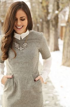 Grey pencil dress with a crisp white blouse & a statement necklace. Winter work outfit.