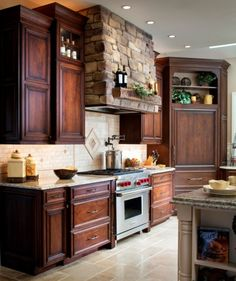 These cabinets are PERFECT! Love, love, love the color combo of the cabinets and island! The only thing I would have a difficult time with is the rock about the stove...imagine how hard it would be to clean the grease from...YIKES! Still love it though!