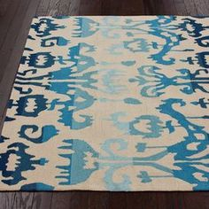 "Hand-tufted rug with an ikat motif.  Product: RugConstruction Material: PolyesterColor: Tan and blueFeatures: HandmadeDimensions: 9'6"" x 7'6""Note: Please be aware that actual colors may vary from those shown on your screen. Accent rugs may also not show the entire pattern that the corresponding area rugs have."
