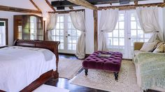 Renée Zellweger's Connecticut Farm is Downright Dreamy//tufted ottoman, exposed beams, sleigh bed