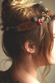 This is a tutorial for a type of flower crown. I haven't done this exact one but i have made my own crown in the past. It is a fun and creative way to add style to your hair. Plus who doesn't like feeling like a Queen as they walk down the street.   http://rootsandfeathers.com/blog/2013/9/9/nature-flower-crown-diy