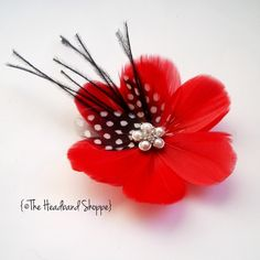 Red Feather Flower Hairclip/Fascinator with Black and White Feather Accents