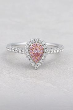 Pink diamond halo ring.