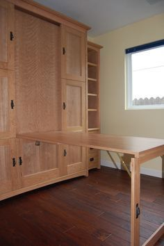 Wallbed (murphy bed) with hidden fold-down table or desk. Perfect for home office that doubles as a guest room.