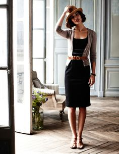 Knee-length black dress belted with cardigan. Add flats or pumps and it's office-appropriate!