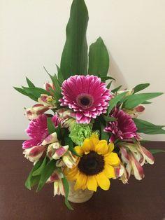Spring arrangement with gerbera and sunflower