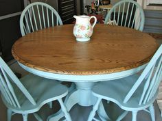 The pedestal base and windsor chairs were painted with ASCP in Duck Egg Blue.   The top was stripped, sanded and stained to reveal a gorgeous grain.