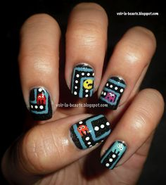 I have to admit, this is awesome!!!! Geek Nail Art!!!!